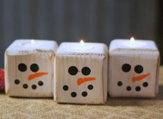 Set of Three Reclaimed Wood Snowmen Tealight Candle Holders. Height Approx: 3.5 Length 3.5 Rustic Primitive Christmas Decor. Adorable Wooden Snowman for Table Top, Mantle, Shelves. Made with Reclaimed Wood that has been Painted white and distressed. Hand painted snowman faces on each one. Fine for use with real or battery tea lights. Top and inside of tea light holes are painted so these are fine to display without any tea light as well. Height Approx: 3.5 Length 3.5 See our other Christ...