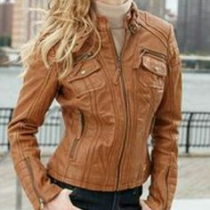 Michael Kors Leather Jacket In good condition, clearing out closet. :) will negotiate price. I bought this a few years ago, it no longer fits me. I worn it a few times. THE COVER PHOTO IS NOT THE ACTUAL JACKET, but its very similar. It has pockets in the front. I can't find the exact picture of the one I've listed at the moment. Sorry I can't model in it, its really big on me. If you have any questions please ask. Michael Kors Jackets & Coats