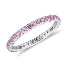 This gemstone eternity ring features a petite row of pink sapphires set in 18k white gold. $550