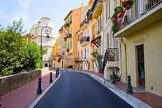 Monaco. The brightly colored buildings and brilliant blue colors of the sea.