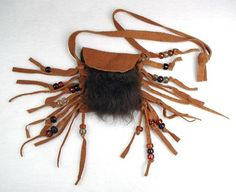 """""""Buffalo Spirit"""" medicine bag. Tobacco colored deerskin with real buffalo fur on front. Pouch dimensions: 3 x 2 1/2"""" (7""""L w/fringe) Clear glass crow beads in tobacco, smoke & water with accent beads in black, sand & sage. Handmade by members of the Pine Ridge Reservation in South Dakota."""