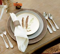 Rattan chargers are the perfect pair for a salad plate with a whimsical, hand-drawn detail.