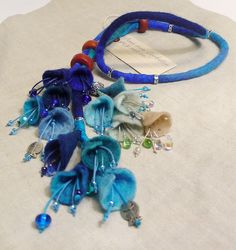 "Necklace | Dans mon corbillon Designs.  ""Sea"".  Felted wool, glass beads and polymer pieces."