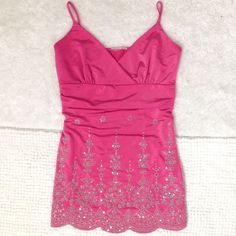 Beautiful pink top In perfect condition.  I cut the tag out because it was itchy so I'm unsure of brand.  Please note that I also made the straps a little shorter by stitching them to the back (see last photo).   I'm happy to do any measurements or take more photos.  Please comment with any questions! N/A Tops Tank Tops