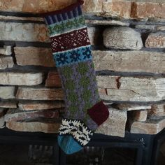 This hand knit Christmas stocking has a rich new color scheme!