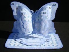 Layered butterfly easel Baby Boy on Craftsuprint designed by Carol Dunne - made by beverly carmichael - Printed on to good quality glossy photo paper. Cut out all pieces. Scored and folded the main piece to form the card base. Assembled the rest of the card following the directions included in the kit using double sided sticky tape and foam pads. Added rhinestones in place of the buttons supplied in the kit. - Now available for download!