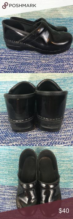 Dansko Black Shiny Career Clog Shoes Slip Resist Excellent used condition, a couple of minor scuffs and some flaws as shown in photos. Slip Resistant, perfect for work and being on your feet all day. Size 40 would be a US women's size 10, but according to Dansko these would also fit a 9.5. Dansko Shoes Mules & Clogs