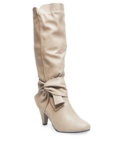 """<p>Get the ultimate girly chic fall look in these cute boots featuring a faux leather bow detail at the ankle. Boots have a textured faux leather body, a tapered heel, stylized stitching, and small slits on both sides of the knee-length shaft. Other features include a half zipper closure at the inner shaft, a lightly padded shaft lining and footbed, and a textured sole for grip.</p>  <ul> <li>Shaft: 15"""" height / Heel: 3.25"""" height</li> <li>Man Made ..."""