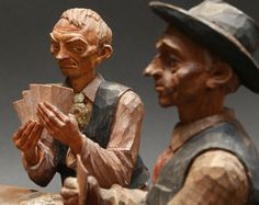 """"""" Poker Players """", close up carved by Emil Janel."""