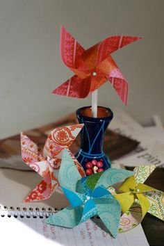Paper Pinwheels 12 Mini Spinnable Pinwheels (custom orders welcomed) Warm Spring Wedding favors. $14.00, via Etsy.