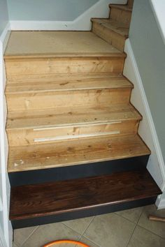 This is AMAZING!  Learn how to install wood stairs using the NuStair system.  It's easy and you can have it done is ONE WEEKEND.  Full details from Designer Trapped in a Lawyer's Body!