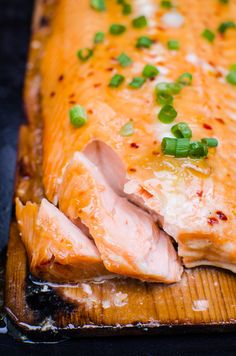 Best BBQ Cedar Plank Salmon Recipe or how to grill salmon on a cedar plank glazed with easy healthy maple Thai sauce that will blow everyone's mind. Yup, we are THAT confident! #cleaneating #salmon #bbq #healthy #dinner #recipe #recipes