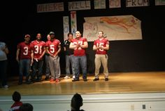 Racine Raiders players and staff are introduced at Julian Thomas Elementary School as part of the Reading with the Raiders program.