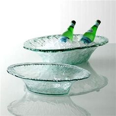 Our large rustic party bowl is perfect to ice down holiday spirits and other beverages. Made from clear recycled glass.