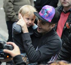 Justin Bieber and his little brother. Awwww