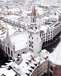 """I woke up early on the first big snowfall of the season to find Munich draped in white. I raced to the city centre and was the first person on top of St. Peter's Church. The silence of the early morning and the pristine rooftops were even more picturesque than I had hoped. At that moment I had a whole winter wonderland just to myself."" -@mjcskye Munich Germany #passionpassport by passionpassport"