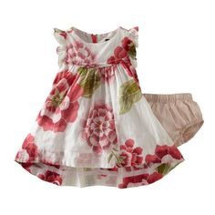 Dress her up in sheer, fine, featherweight voile, detailed with pintucks and festooned with bright blooms.  Lined.
