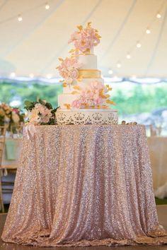 Blush wedding cake with roses.
