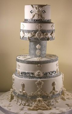Bling Wedding Cake - The ultimate princess cake - A four tier bling wedding cake decorated with rhinestone/diamante bands, Swarovski crystals and gems and royal motifs.
