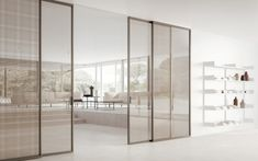 The Mitika internal door is also available as a sliding, bi folding or pocket door system. The slim aluminium frame holds glass door that can slide into pockets or over fixed glass panels, available in a wide range of finishes. Sliding Door Room Dividers, Sliding Door Panels, Internal Sliding Doors, Sliding Door Design, Room Divider Doors, Sliding Wall, Sliding Glass Door, Modern Sliding Doors, Office Interior Design