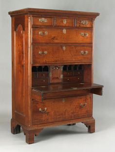 Pennsylvania Queen Anne walnut tall chest, ca. 1760, the molded cornice above 3 short drawers and 4 long drawers, centered by a faux drawer with fall front, enclosing a fitted interior with raised tombstone panel prospect drawer, all flanked by smooth quarter columns and raised panel sides supported by straight bracket feet, 69.25 H. x 41.5 W.