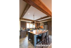 A slab of driftwood, wired with lights, illuminates the kitchen island. The owners prowled stores on Toronto's Queen Street West for inspiration when designing the lighting.   Via OUR HOMES Peterborough Fall-Holiday 2016 http://www.ourhomes.ca/articles/build/article/toronto-weekenders-finish-chalet-with-sweat-equity
