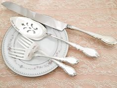 What a perfect keepsake!  These are vintage silver plated forks, and cake server *****knife NOT included in this listing*****  Theyre the pattern Alouette from 1978.  Keep in mind they are true vintage, but these polished up really well and are gorgeous.  I can put names, date, etc on the forks and server. I will use this fun font shown. If you dont specify other wording, I will do them exactly as shown. More forks and sweet wedding stuff here: http://www.etsy.com/shop/Lor...