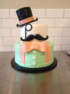 We call him Mr. Peanut with his monocle, mustache, bow tie and top hat. Cake by TracyCakesAR.