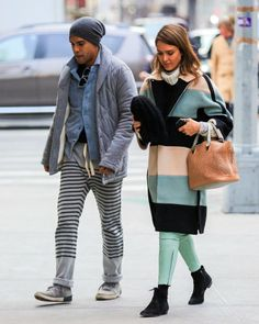 While strolling with a friend, Jessica made use of the same thick-striped coat on March 4. This time, though, she warmed up the look with a cozy white turtleneck and played into the topper's cool color scheme with a pair of mint-hued bottoms and black booties.