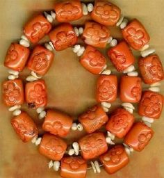 Strand of Salmon Colored Coral Hand Carved