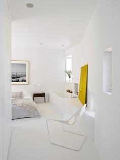Slanted Roofs in a Minimal Apartment in Madrid – NONAGON.style