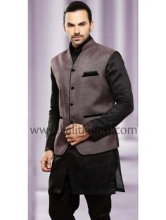 Baronial black color linen short kurta with matching bottom and chocolate brown color jacket. Item code : SKB2282J http://www.lalitkhatri.com/label/men/mens-short-kurtas.html