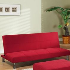InRoom Designs Klik-Klak Convertible Sofa - with Metal Frame. Convertible sofa with contemporary style. Cotton canvas fabric upholstery in red. Metal frame, foam core. Modern metal chrome legs. Dimensions: 67L x 35W x 30H inches.