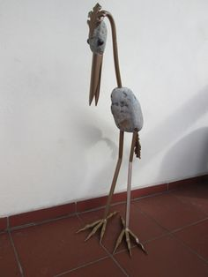 the bird made of gray stones and metal