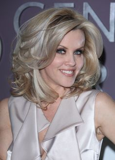 Jenny McCarthys wavy, voluminous hairstyle