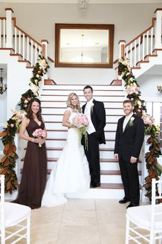Wedding Ceremony on the grand staircase at the Garden Chateau in Central Florida!  Look at the beautiful magnolia garland on the railing!!!