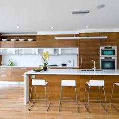 teak veneer cabinets, maple floor (possibly bamboo)