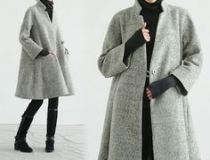 Trapeze coat, A line. Bracelet sleeves. Super simplicity with one Chinese frog button at planket. Fully lined.  * Materials:  Outer: 50% wool blend
