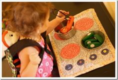 Roll-up play kitchen tutorial. Sew a stove play mat - here's how, step by step. This DIY Craft is a great gift for the toddler or children in your life.