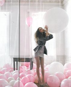 Room filled with pink + white {balloons}