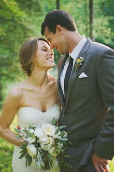love this bouquet - and look! grey suit/black tie :)