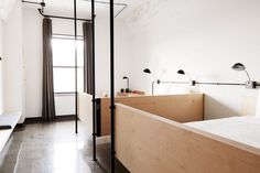 A pared-back palette of greyscale tones and timber creates a minimal feel in the dorms at The Hollander hostel, Chicago