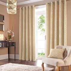 Equipped with an eyelet header for easy fitting, our fully lined curtains feature jacquard patterning on a gold background and are available in a range of width...