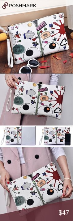 Graffiti Calutch This clutch is so much fun! It's truly necessary to have fun things at any age. Bags Clutches & Wristlets