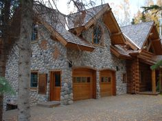 Log home with stone garage