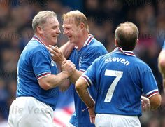 Old team-mates Ally McCoist and Jorg Albertz congratulate each other after both getting on the scoresheet