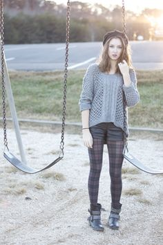 plaid grunge at the park, #fashion, #style, combat boots, oversized sweater, leather shorts, hat, tights