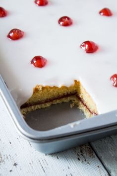 Iced Bakewell Tart Tray Bake complete with a cherry on top. Perfect for…