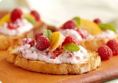 Raspberry Ricotta Dip (1 cup part-skim ricotta cheese  3 tablespoons plain yogurt  3 tablespoons raspberry jam  1/4 teaspoons vanilla extract  2/3 cup Raspberries)