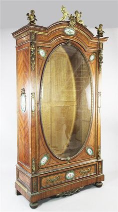 A large 19th century French Louis XVI style display cabinet,